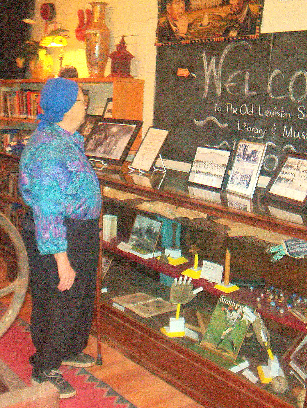 Schoolhouse founder, Doris Callahan, oversees relics in the historical museum that once belonged to her grandfather, from his time as a student