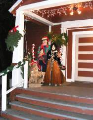 More samples of Michele de Onate's artwork: three life-sized papier mache figures on the front porch that delighted Schoolhouse patrons during the annual Holiday Open House